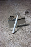 Cigarette with lighter Royalty Free Stock Photo