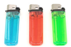 Cigarette lighters. Three colorful cigarette lighters in row Stock Photos