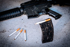 cigarette in Magazine gun. Stock Image