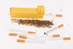 Cigarette maker, tubes and tobacco. On white background Royalty Free Stock Photo