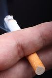 Cigarette in man`s hand. Stock Photography