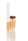 Cigarette and matches associated with string isolated on white Stock Image