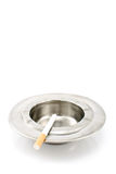Cigarette  in  metal ashtray Stock Photography