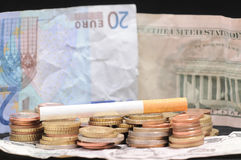 Cigarette and Money Royalty Free Stock Photography