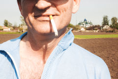 Cigarette in mouth Royalty Free Stock Photo