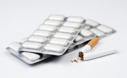 Cigarette and nicotine chewing gum. Stock Image