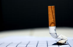 Cigarette off. On gray background nuanced stock photo
