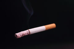 Cigarette On A Black Background Royalty Free Stock Photo