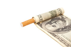 Cigarette and one hundred dollar bill Royalty Free Stock Photos