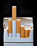 Cigarette pack. Closeup of cigarette pack on black background Stock Photo