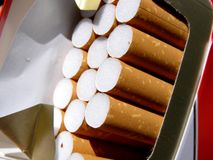 Cigarette pack. Detail photo of the cigarette background Royalty Free Stock Images