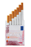 Cigarette packet. Cost of a bad habit.Isolated with Clipping Path Stock Photos