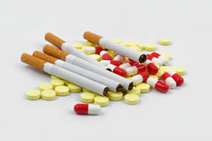 Cigarette and pills Royalty Free Stock Image