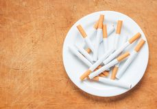 Cigarette on a plate top view Stock Images