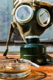 Cigarette with pot and gasmask Stock Image