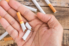Cigarette roll in hand holding. Close up cigarette roll in hand holding Stock Images