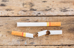 Cigarette roll on old wooden table Stock Image