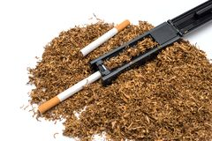 Cigarette rolling machine and empty cigarette tube and tobacco Royalty Free Stock Image