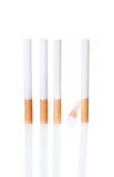 Cigarette in the Row with One Fallen Royalty Free Stock Photo
