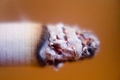Cigarette's lit top closeup Stock Image