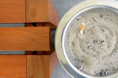 Cigarette in sand ashtray bin Royalty Free Stock Photo