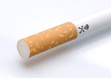 Cigarette with skull  Royalty Free Stock Photos
