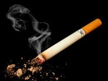 Cigarette with skull. On black background Stock Image