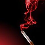 Cigarette smoke. Burning cigarette with smoke on black background Stock Photo