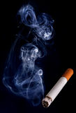 Cigarette and smoke Royalty Free Stock Photo