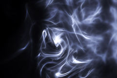 Sunlit smoke. Ambient tobacco smoke turbulence in the air Royalty Free Stock Images