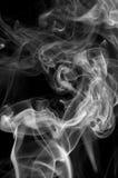 Cigarette smoke background. On black stock images