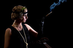 Cigarette smoker in twenties style Royalty Free Stock Image