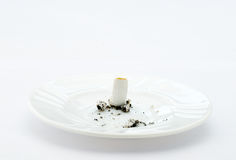 Cigarette and smoking. A cigarette butt,one cigarette on white background,spent cigarette,stop smoking Stock Photography