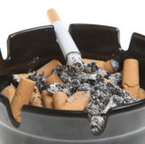 Cigarette Smoking in Ashtray. Cigarette smoking in a full ashtray Stock Images