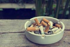 Cigarette stub in ashtray Stock Photography