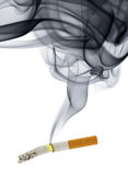 Cigarette stub with smoke Royalty Free Stock Image