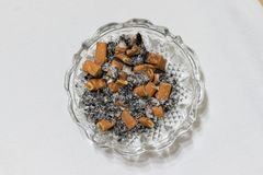 Cigarette stubs and ash stock images