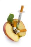 Cigarette syringe in aple Stock Photo