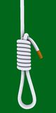 Cigarette tied in a gallows Royalty Free Stock Photos