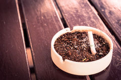 Cigarette trash. Cigarette butt in the cigarette trash bow Royalty Free Stock Photo