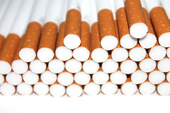 Cigarette Tubes isolated on white background. Cigarette Tubes Isolated on white colored background Royalty Free Stock Image