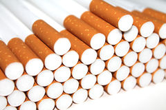 Cigarette Tubes on white background Royalty Free Stock Photography