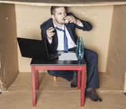 Cigarette and vodka in businessman hand Stock Photos
