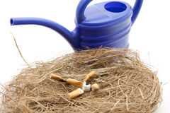 Cigarette with watering can Royalty Free Stock Photos