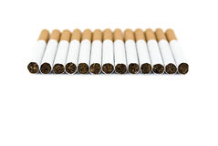 Cigarette on a white background. Many cigarettes on a white background Royalty Free Stock Image