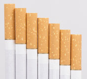 Cigarette. On a white background closeup Royalty Free Stock Images