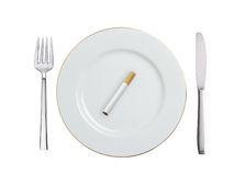 Cigarette on white plate isolated on white Stock Photo