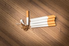 Cigarette on wood background Royalty Free Stock Images