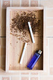 Cigarette wood background Stock Images