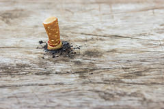 Cigarette on wooden Stock Photography